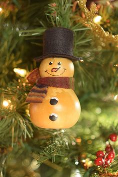 Kolden is our natural snowman ornament with an adorable painted face. He is approximately in diameter. Christmas Crafts For Adults, Christmas Ornament Crafts, Christmas Tree Ornaments, Christmas Time, Crafts For Kids, Adult Crafts, Snowman Ornaments, Hand Painted Gourds, Pine Cone Decorations