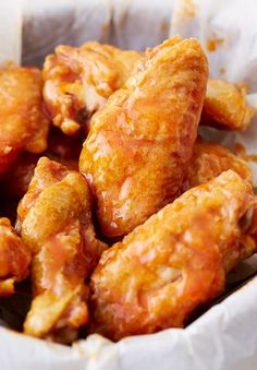 These baked chicken wings are extra crispy on the outside and very juicy inside. They are like deep-fried wings, only without a mess and added calories. Oh, and they only take 30 minutes to bake. Tossed in garlic/butter/Frank's hot Buffalo wing sauce.