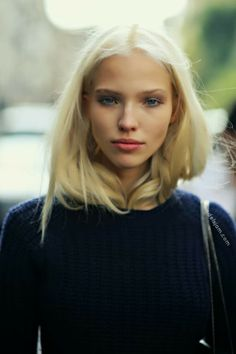 Sasha Luss wearing a navy sweater.