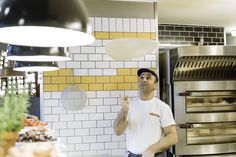 Pizzaiolo with pizza dough | L'Osteria | Pizza E Pasta