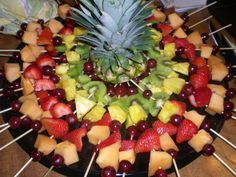 Any Occasion Fruit Tray. Use baking/grilling sticks and put on fruit. Fruit as per picture: Grape, Cantaloupe, Strawberry, Grape, Pineapple, Kiwi, Grape.   Fruit is so colorful and beautiful and this adds such a great pop of color to any dining setting. Then take the head of the pineapple and put it in the middle as a centerpiece. This is the perfect example of how sometimes simple is the best way to go.