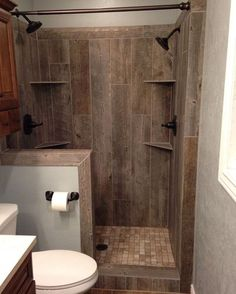 You need to take a second look at this bathroom to see that it's actually tile disguised as wood. We love this look but how would you feel if this was in your bathroom? #DesignDebate #RenovateToRent