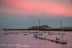 2 of 2: Just before 5pm tonight an unusual phenomena occurred in St Peter Port.The town & harbour turned pink for approximately 5 minutes. Quite an extraordinary sight if you were there! #Guernsey #GreatThings  Link to the whole collection of 'Georgie's Guernsey' :-http://chrisgeorge.dphoto.com/#/album/4daaes  Picture Ref: 30_10_15 — in St. Peter Port, Guernsey, Channel Islands.