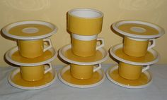 Vintage Mikasa cup and saucer set with uncovered sugar bowl. So Retro! 15 piece egg yolk yellow and white set from the 1970s. C7300, D5350, D5352. By AngelGrace, $45