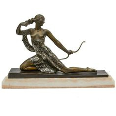 "A French Art Deco archer figure, ""Diana the Huntress"" by Joseph Descomps (born J.E. Cormier, French, 1869-1950), from circa 1928. Patinated and enameled bronze, mounted on a white-yellow onyx base. Signed in the bronze. Height: 16.5"""" Width: 25.5"""" Depth: 5."""