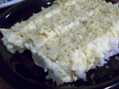 Coconut, Pineapple, Rum Cake 							  Optional for the winter parties!   You can bake this in 2 medium metal bowls, (using foil to keep stable while baking) to form a snow ball when put together. You just need to slice a piece off the bottom (round part) so it can sit stable and frost with cream top with other half and frost with rest. Cover with coconut flakes.