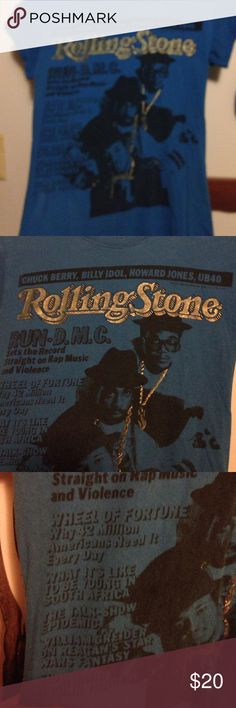 Rolling Stone t- shirt Rolling Stone t-shirt size L featuring Run-D.M.C.   Chuck Berry, Billy Idol, Howard Jones, UB40 it says Run -D.M. Sets the record straight on rap music and violence/ wheel of fortune why 42 million Americans need it every day, what its like to be young in South Africa, the talk show epidemic, William Greider on Reagan's Star Wars fantasy, Sid and Nancy a punk tragedy. I'm almost positive that this was a real cover of Rolling Stones back in the late 80's early 90's…