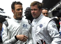 He even looks good in the rain! Brad Pitt gets caught out in a torrential downpour as he prepares to start Le Mans 24 Hours | Daily Mail Online