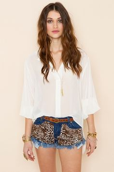 who couldn't use a basic white chiffon blouse like this one