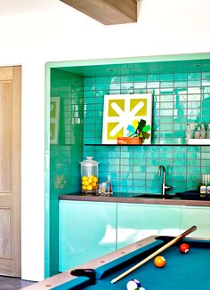 Green tile in mini kitchen and bar