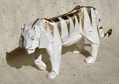 White and gold tiger origami