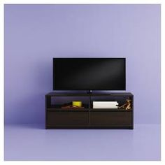"""The Room Essentials TV stand has 2 drawers and 2 open shelves to hold your electronic items, media and more. It can hold almost any 40"""" flat panel television set. 80 lbs. capacity. Wipes clean with a damp cloth."""
