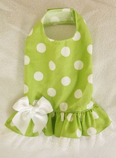 """- Cute lime colored party dress - Two layered skirt - White bow at waist - It easily attaches with adjustable velcro neck and belly straps - Open chest design XXXS fits 7 - 9"""" chest dress length is 6."""