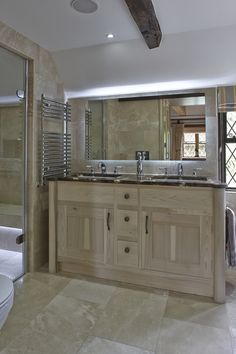The furniture is crafted in washed tulip wood which has a silvery blond quality in daylight and further enhances the light and airy feel. Vaulted Ceiling Bedroom, Airy Bedroom, Bedroom Wardrobe, Bespoke Kitchens, Bathroom Furniture, Luxury Interior, Master Bathroom, Beautiful Homes, Architecture