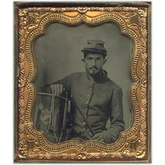 Pvt. William G. Bryant 20th Tennessee Infantry  The tintype of Bryant in his gray frock coat and cap is unique not only because of the documentation of his name and unit, but also for the drum with which he posed. The folk art painting on the side of the rope tension snare drum has a patriotic Confederate motif and shows three Confederate first national flags surrounding a shield with the red, white and blue national colors.  After entering Confederate service, Private Bryant and his…