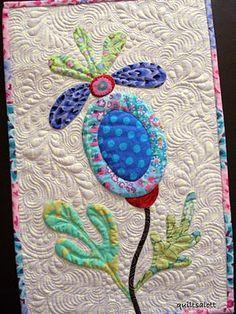 Beautiful applique and quilting. Quiltsalott.blogspot.com
