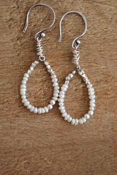 Pearl Silver Hoop Earrings: Fresh Water Seed Pearls,  Artisan Dangle Earrings, Handmade Jewelry. $48.50, via Etsy.