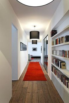 Modern entrance hallway bright white decor built in storage red runner
