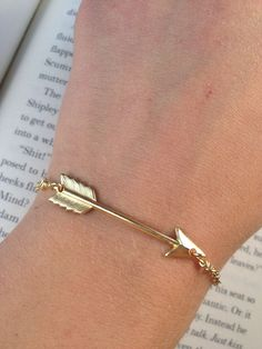 Arrow Bracelet- Simply Gold Arrow Bracelet- Hunger Games Inspired- Bridesmaids Gift- Gold Casual Jewelry- Arrow Jewelry. $20.00, via Etsy.