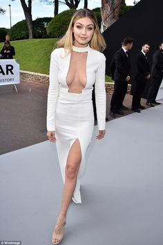 Gorgeous Gigi: The 20-year-old model was stunning in a plunging Tom Ford dress at the amfA...
