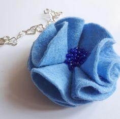 A personal favourite from my Etsy shop https://www.etsy.com/uk/listing/506177813/blue-brooch-fabric-flower-brooch-felt
