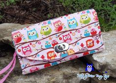 Check out this item in my Etsy shop https://www.etsy.com/listing/278339820/owls-necessary-clutch-wallet-pink-owls