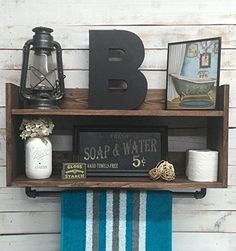 Bathroom shelf unit, bathroom towel shelf, home décor, bathroom storage, bathroom storage organizer, bathroom wall shelf. This rustic wood and industrial pipe shelf with is assembled out of steel pipe and wood. It will make an eye catching display in your bathroom. The unique design of this item will add character and flare to your home. It will be perfect accent to your rustic industrial look. It can be used for over the toilet storage or anywhere in your bathroom. Handmade item, unused....