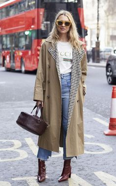 Roberta Benteler, founder of Avenue 32, wears a trench coat by Isa Arfen with a Gucci logo tee, and classic blue jeans.