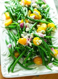 Bean Salad with Tomatoes and Feta - Hericots Verts, a light vinaigrette, a bit of cheese and onion...perfect summer salad!