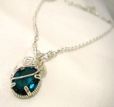 My birthstone and so pretty!  Glass Emerald Necklace - Dark Green Glass Emerald Pendant - Wire Wrapped Crystal Jewelry. $25.00, via Etsy.