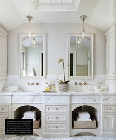 Modern french country chic white bathroom with marble top double basin & mirrors with beige storage & cane straw basket