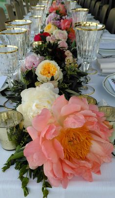 L&B's long garland with ombre spring flowers. May 24wedding reception table @violamalva