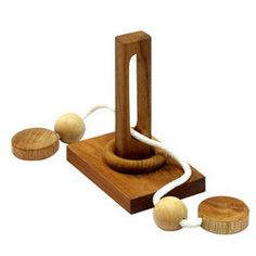 Ring Release - Wood & String puzzle.  http://shop.siammandalay.com/collections/disentanglement-puzzles/products/ring-release
