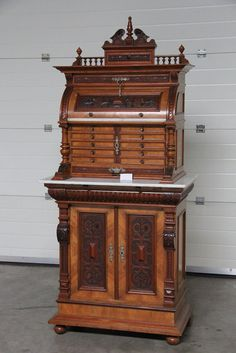 BEAUTIFUL Antique German Medical Cabinet in Walnut dating from the 19th century. A Rare and stunning model in very good to excellent condition. We purchased this piece from a home in Belgium where as you can see it enjoyed wonderful care during its like. We are not sure if it was used for Dentistry or simply as a General Medical practitioners cabinet. Questions? Please give us a call. Dont forget to ask about our in store Layaway opportunity. Measurements: 63 wide x 37 deep x 30 1/8 high…