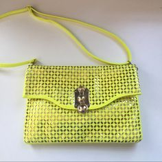 "Metallic Gold & Yellow Purse/Clutch Yellow purse with metallic gold cutouts and hardware. Adjustable and removable strap. Can be carried as a clutch. Zipper closure. 1 inside pocket. NWT. 12.5"" wide. 8.5"" tall. Bags"