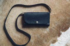 Hustle & Hide Co black wallet clutch with detachable strap