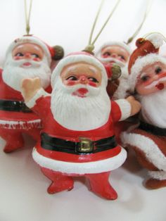 10 Vintage Plastic and Flocked Santas - 1950s or 1960s Christmas Decorations Ornaments - Made in Hong Kong. $10.00, via Etsy.