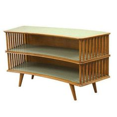 Bookshelf by Joaquim Tenreiro, Brazil, circa 1960 | From a unique collection of antique and modern shelves at https://www.1stdibs.com/furniture/storage-case-pieces/shelves/