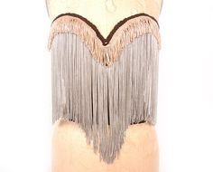 Vintage 34B black Carnival bustier altered by Marina Williams with two layers of fringe, 2 cream/tan fringe and 9 gray fringe.