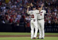 Atlanta Braves Chipper Jones #10 ,and teammate Freddie Freeman celebrate after beating the New York Mets at Turner Field