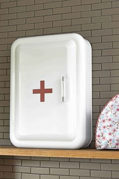 This fab new Metal First Aid Cabinet is really top quality and a decent family size. White-painted metal with a red cross on the front, with a chrome handle and three internal shelves, giving you loads of storage space for your medicines, etc.  Please note that this cabinet does not lock and thus should be fixed out of the reach of children. Wall fixings supplied.
