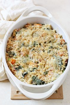 Comforting sweet potato and kale brown rice casserole! Made with greek yogurt and some cheese, it's a lighter casserole with no cream of anything soup!