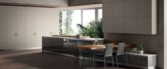 Scavolini LiberaMente Pearl grey leather doors for wall units and Switch cupboards, with visible stitching.