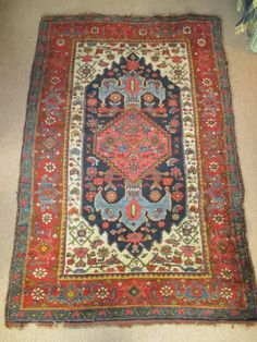 Antique Hamadan rug in our collection of antique rugs, carpets and textiles. 19th Century - wonderful lustrous thick wool pile on wool warp and weft. Lovely colours - including a pinky madder, an overdyed pea green and a pale light blue in the anchor motifs of the central medallion.