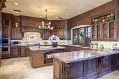 """View this Great Traditional Kitchen with Complex granite counters & Custom hood in San Diego, CA. The home was built in 2007 and is 10750 square feet. Discover & browse thousands of other home design ideas on Zillow Digs. Dark Wood Kitchens, Rustic Kitchen Cabinets, Rustic Kitchen Design, Best Kitchen Designs, Modern Farmhouse Kitchens, Farmhouse Style Kitchen, Home Decor Kitchen, Interior Design Kitchen, Cool Kitchens"