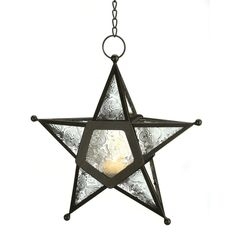 Add a candle to this five-pointed star to fill the night with celestial light! Artistic hanging lantern features ornate panels of clearest glass set into a wrought-iron frame. Weight 0.8 lb. Iron and