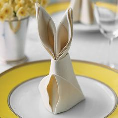 "Easter-rabbit-shaped napkins are a festive detail for the holiday table, and they only require a few simple folds. Well-starched crisp cotton or linen will transform into the sturdiest bunnies. Fold napkins the day before your meal so your ""warren"" is full when guests arrive."