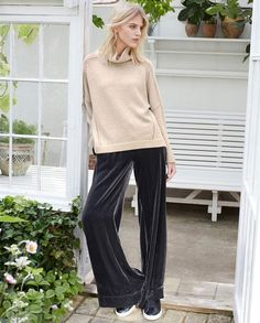 Gigi trousers - Very glamorous wide leg trousers, generously cut to floor-skimming length in a deep blue that shimmers and catches the light. Gathered at the waistband with a drawstring closure, side pockets and patch pockets at the back. 80% Viscose 20% Silk