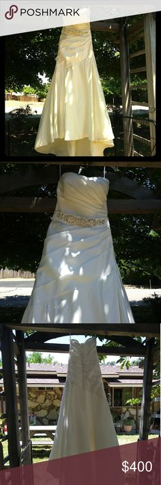 Jasmine wedding dress Ivory Jasmine wedding dress with Jewel belt detail size 12 but altered to fit me I am 5-5  and 135lb.... dress is clean but has a few marks on the train can be removed with dry cleaning..... Jasmine Dresses Wedding