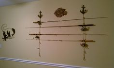 I made a fishing pole holder. there are the two anchor wall mountings from hobby lobby($$5.99 each) and then from each one I tied rope with loop nots on it to hold the rods and reels!!!